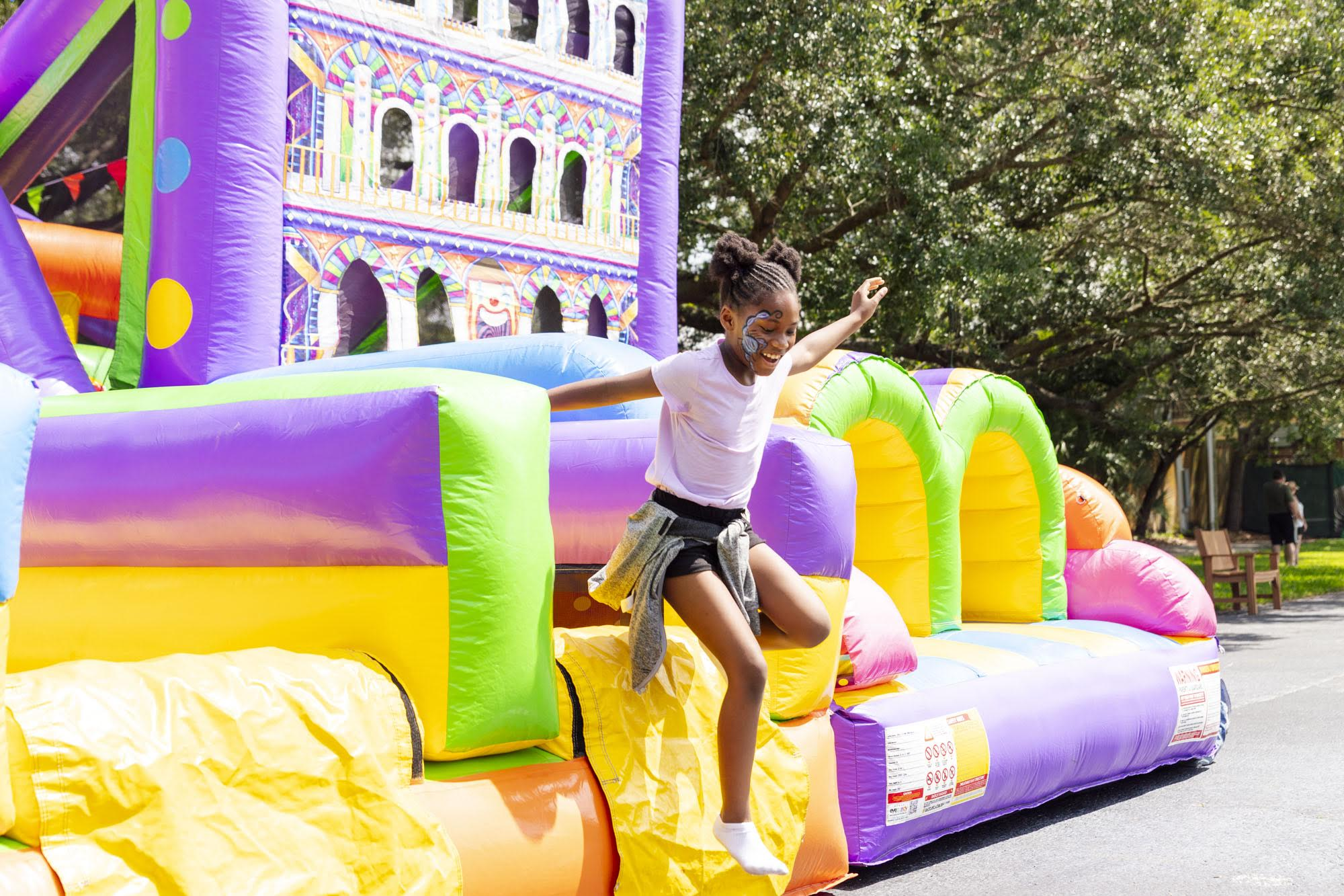 girl enjoying inflatable slide at zootampa