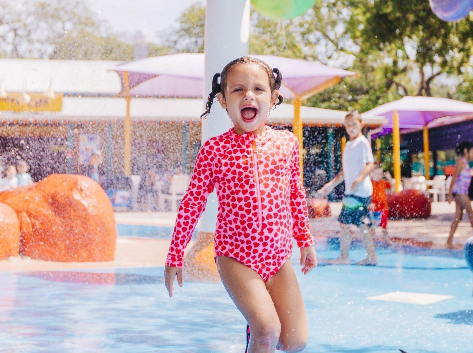 A photo of a girl and other children splashing around enjoying the Wallaroo Splash Pad at ZooTampa