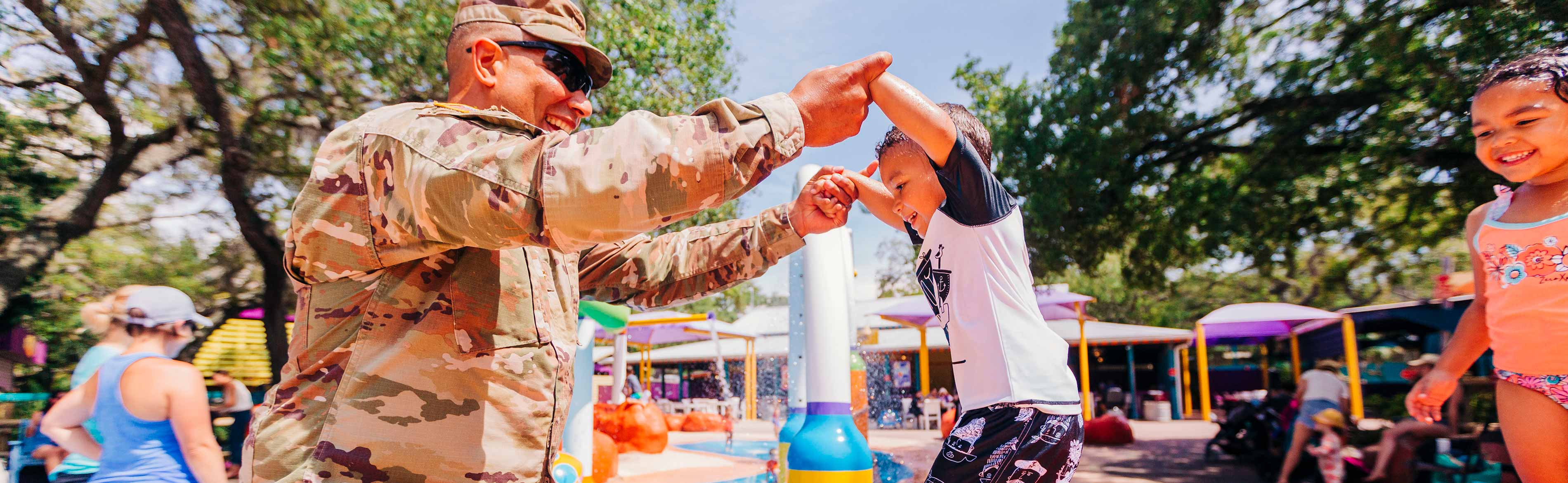A military serviceman and his family enjoy ZooTampa at Lowry Park