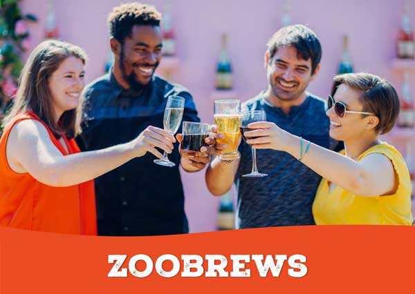 A group of adults mingle with animals and enjoy food and drinks at ZooBrews