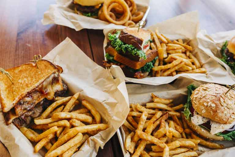 Burgers, BLTs, fries and onion rings served at Macaws Landing Cafe