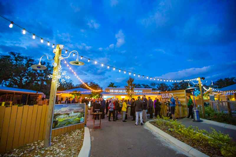 A private event is held outdoors and indoors at the Conservation Center at the Zoo