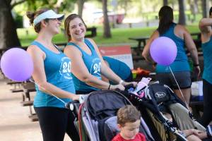 Moms exercise with their kids in strollers during FIT4MOM Stroller Strides