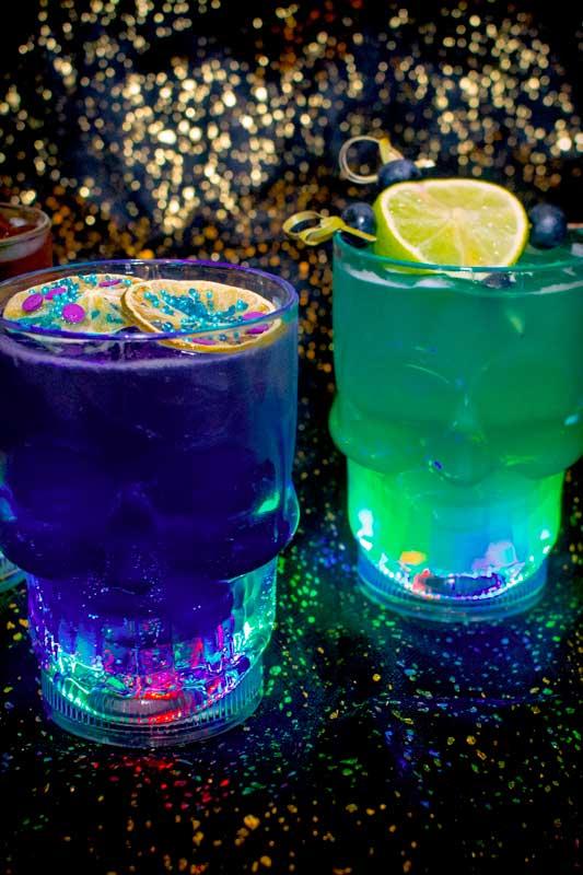 Creepy mixed drinks in skull glasses