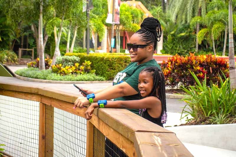 Mom and daughter exploring the Zoo with their TRAKID Wildlife Explorer Compass